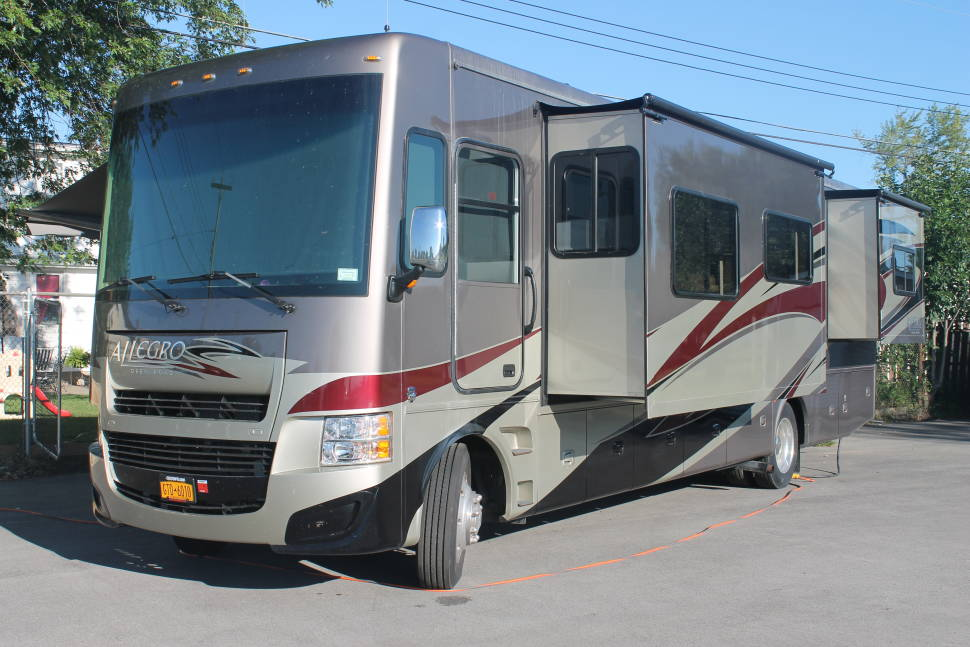 2013 Tiffin Allegro - Travel 1st Class!! You will not find this unit in your normal commercial rental fleet. This is a top of the line Tiffin with all the options, 4 Slideouts for maximum space, Auto Leveling and Maximum Storage