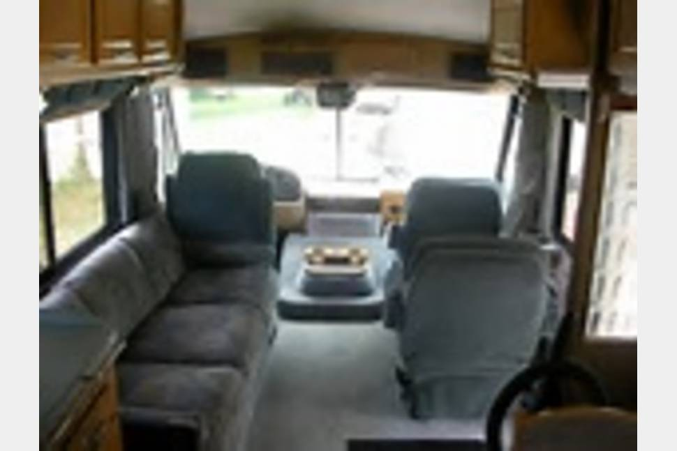 1994 Southwind Fleetwood - The RV has 2 rooftop air conditioner units, 2 exterior awnings, upgraded suspension for greater ease of handling on roadway.