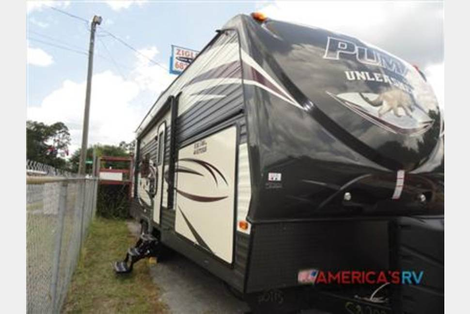2016 Palomino Puma 25TFS Premier Toy Hauler - New Toy Hauler Camper with 4 Queen beds & Outdoor Kitchen and Outdoor Entertainment area