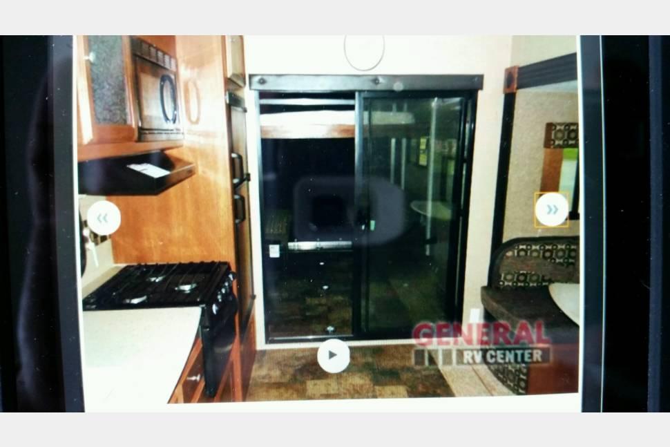 2015 Coachmen Freedom Express 301BLDSLE - Hennip's Mobile Hideaway