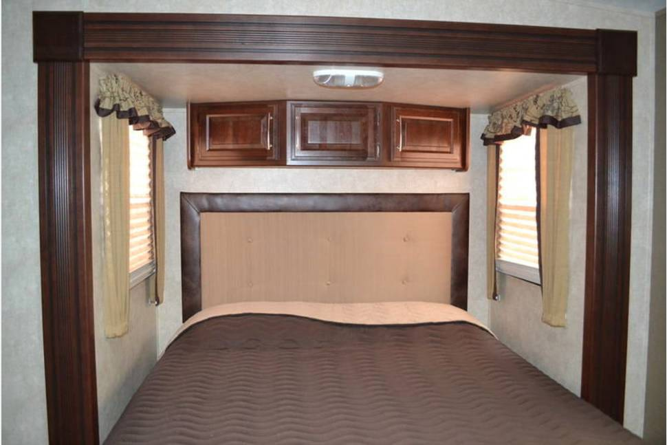 2015 Keystone Cougar 337FLS High Country - Unique front living room with large L-shape couch and convertible sofa.