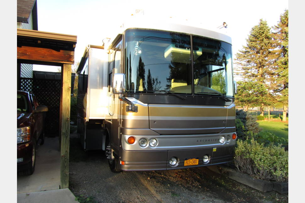 2003 Fleetwood Excursion - Travel like you are in the comfort of your own home. Enjoy the comfort of a Sleep Number bed. This RV even has a washer/dryer in it.