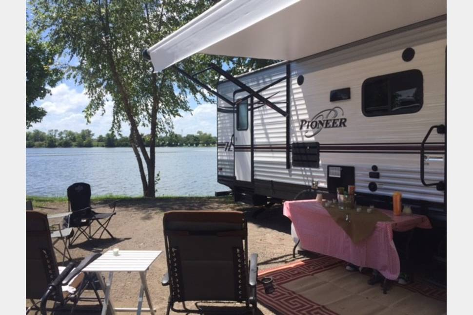 2015 Heartland Pioneer - WANDERLUST is the perfect camper for Fall, Football, Smores, Campfires and More! Need extra space for the holidays? We've got you covered!