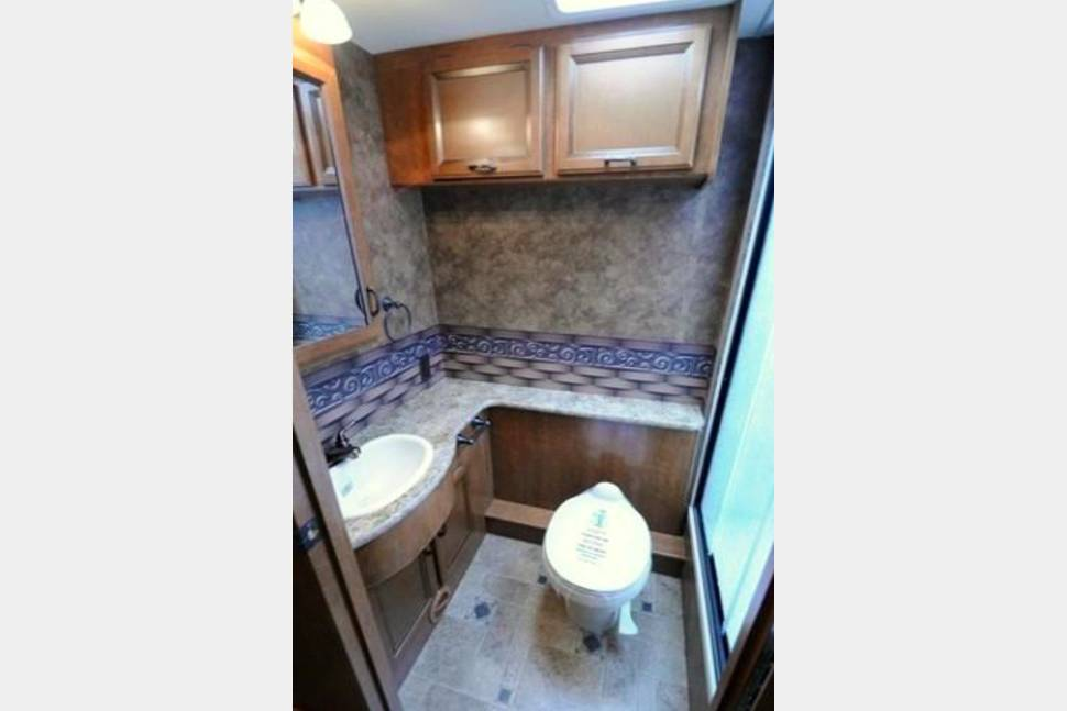 2014 Harry The RV Thor Hurricane 34J - Harry the RV is a Thor Hurricane 34J He is a 35ft Super Snazzy Rig with Outdoor kitchen and TV. Sleeps 10